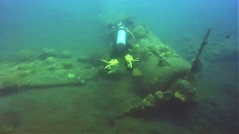 Scuba diver explores mysterious WWII fighter plane wreck