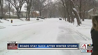 Roads stay slick after Saturday storm