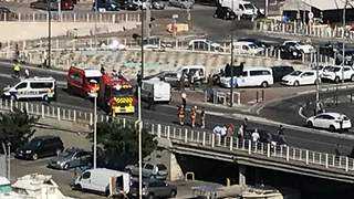 Emergency Vehicles on Scene in Marseille Following Reports of Vehicle Hitting People at Bus Stops - Video