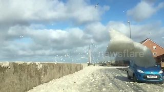 British seafront covered in sea foam after Storm Ophelia - Video