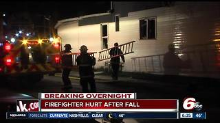 Indianapolis firefighter injured after falling through house roof - Video