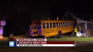 School bus crashes into home on Detroit's west side