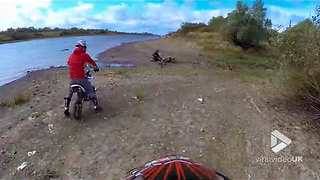 Motorbiker goes flying over handlebars - Video