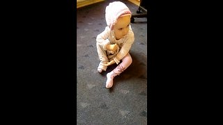little girl trying to dress up by herself