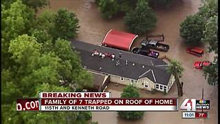 Family of 7 stranded on rooftop in Overland Park - Video