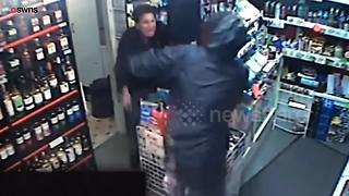 Incredible CCTV footage shows moment female corner shop worker confronts knifeman with own blade - Video