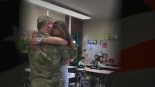 Soldier surprises step-children in school after year-long deployment