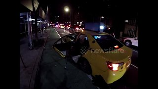 Touching moment cyclist helps an elderly stranger get out of New York taxi