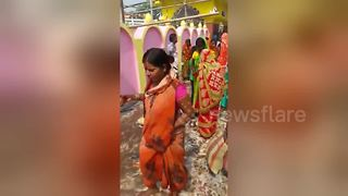 Indian women accidentally worship dustbin during major festival