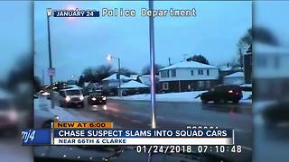 Wauwatosa chase suspect clams into squad cars - Video