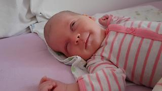 Sleeping Newborn Baby Smiles for the First Time!  - Video