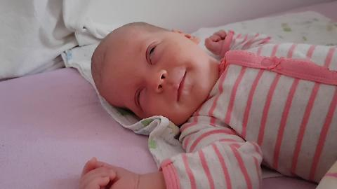 Sleeping Newborn Baby Smiles for the First Time!