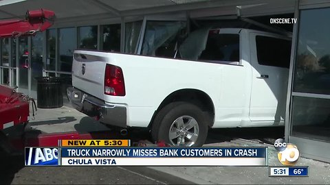 Truck narrowly misses bank customers in crash