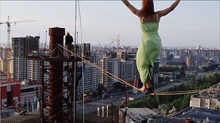 Dressed To Impress: Daredevil Highlines Above Russian City Wearing Dress