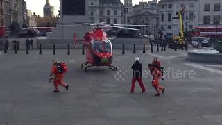 Air Ambulance helicopter lands in London's Trafalgar Square - Video