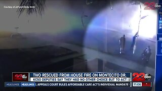 KCSO deputies rescues elderly couple from burning home