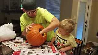 Toddler Carves His First Pumpkin and is Horrified by What's Inside - Video