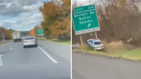 Vehicle drives off the highway, jumps ramp right underneath road sign