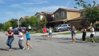 Neighbors dance first conga line to respect social distancing
