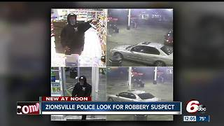 Zionsville gas station clerk refuses to give up register, robber steals Riley donation jar - Video