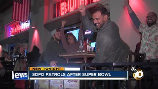 San Diego Police Officers monitor Super Bowl partiers