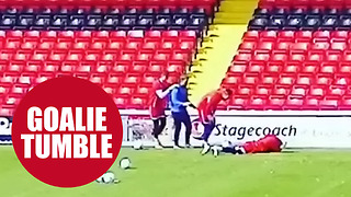 Footage shows hilarious moment a goalkeeper falls into back of the net - Video