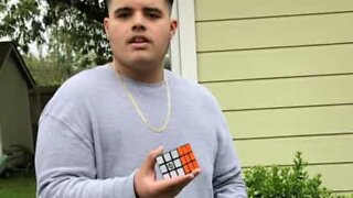 Man solves Rubik's cube instantly