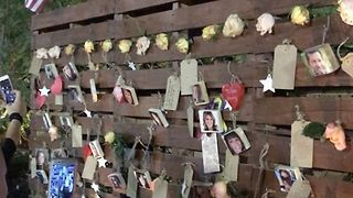 Faces of Mandalay Bay Victims Cover Healing Garden Wall - Video
