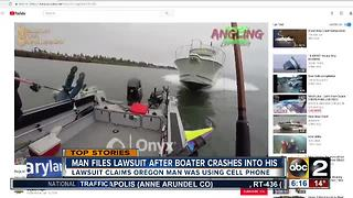 Fisherman suing over head-on boat crash - Video