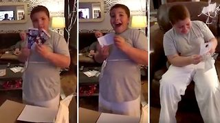 10 year old's heart melting reaction to surprise NY Giants tickets - Video
