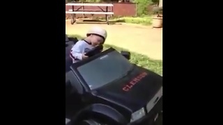 Kid adorably falls asleep at the wheel