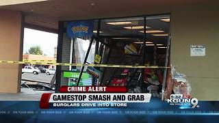 Car drives into Gamestop, TPD searching for suspects - Video
