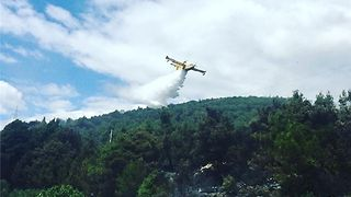 Planes Drop Water on Fire Raging Along Croatian Coast - Video