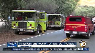 Firefighters work to protect homes - Video