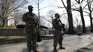 New York National Guard Soldiers stand guard over U.S. Capitol