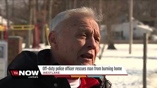 Off-duty Westlake police officer saves elderly man from burning house - Video