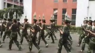Cadets march while balancing water bottles on their heads - Video