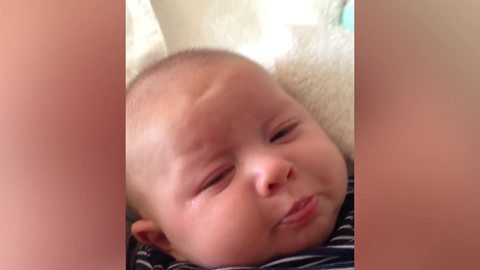 A Baby Boy Frowns When His Mom Asks Him To Smile