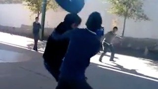 FAIL! Guy attempts to throw tire at two friends - Video