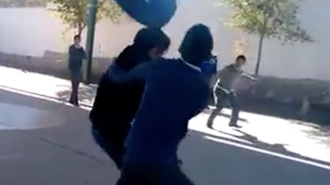 FAIL! Guy attempts to throw tire at two friends