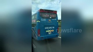 Reckless bus driver caught steering packed coach with his FEET - Video