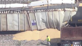 Train collides with railcars near downtown Indy causing spill, several road closures - Video