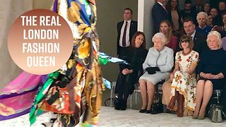 The Queen makes a splash front row at Fashion Week - Video