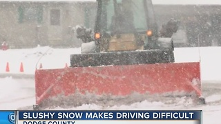 Slushy snow makes travel difficult in Dodge County - Video