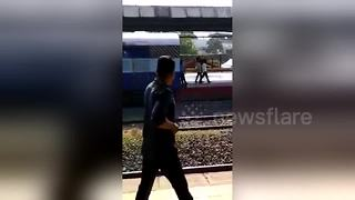 Onlookers use stones to stop train which starts rolling on its own - Video