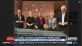 Clark County officials sign banner for Parkland - Video