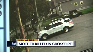 Surveillance footage shows how a mother of 2 was caught in the crossfire