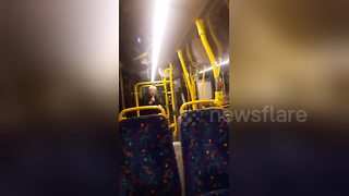 Bus passengers cheer up with elderly man impromptu performance