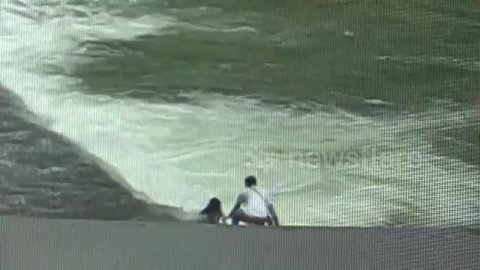 Passerby saves girl after she falls into fast-moving river in southwestern Chinese province