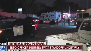 SDPD Officer injured, SWAT standoff underway - Video